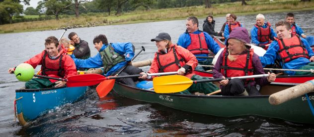 disability friendly family activity break, rafted canoes paddling on bassenthwaite lake playing canoe polo