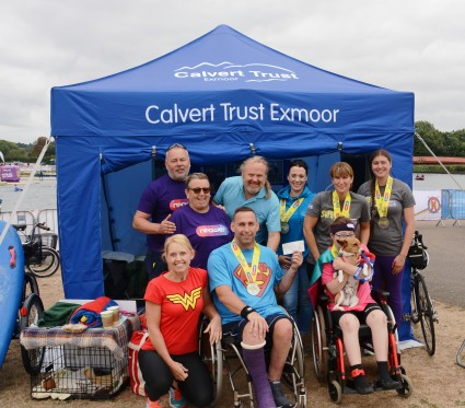 Shaun Gash presents cheque to Calvert Trust Exmoor after Superhero Tri with funds raised from Ben Nevis Climb