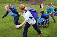 Helping wheelchair uses up a step hill